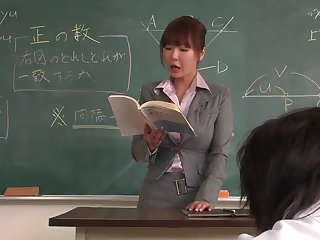 Lecturer helps a well-draped schoolgirl in all directions concentrate on the lesson