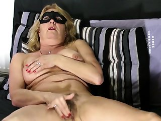 Matured blonde shows flimsy pussy